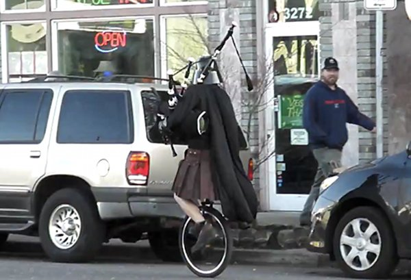 Darth Vader Riding a Unicycle and Playing the Bagpipes