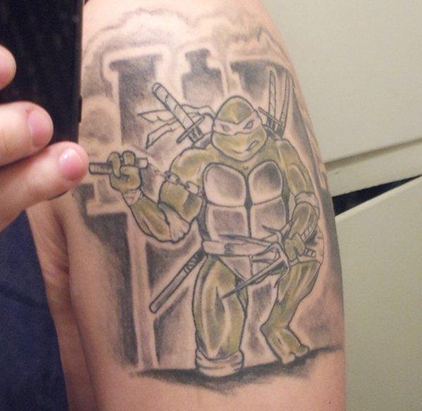 Teenage Mutant Ninja Turtles Arm Tattoo